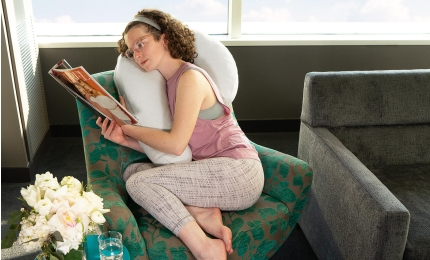 Model reading with Avana Uno Snuggle Pillow